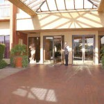 The front entrance with a bellman holding the door